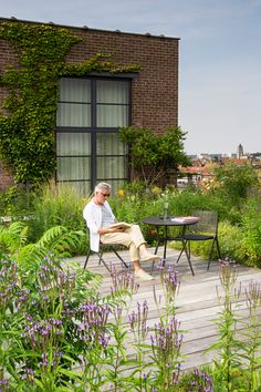 Rooftop garden in the city of Brussels, Belgium, with bistro table and side chairs from the Branch collection by Tribù.