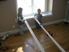 Buy a length of rain gutter, cut it in half and then you've got two race tracks.  Gonna have to look into this!