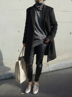 *python slip on sneakers, leather pants, grey turtleneck sweater, black coat