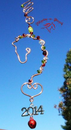 ~Wired Whinnies ~ by Rhythm-n-Beads TM are whimsical wire horse Suncatchers....lovingly hand fashioned from copper wire and accented with beads & charms. Hang your 'wired whinnies' ... * in a window *from a rear view mirror * from a lamp * in the tack room * on the Christmas tree or a wreath during the holidays, or......the possibilities are endless :) Wire Horse Suncatchers, Rearview Mirror Dangles, Horse Ornaments