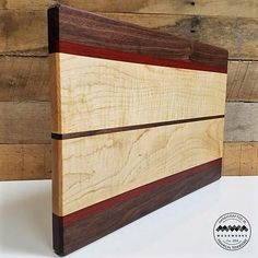 "Your cutting board doesn't have to be ""plain Jane"". Why not have one that's as beautiful as it is functional? A functional work of art! MWA Woodworks provides cutting boards in many styles, colors and sizes to provide you just the right balance of utility and ""wow"". Perfect for wedding, birthday, and house warming gifts!"