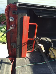 """Homemade truck bed tie downs ,made from scrap angle iron and 1/2"""" steel rod . Tie down is 12"""" tall with a support welded in the middle . I bent the rod and drilled the angle iron ,weld both sides and ground the back flat. To install you have to take off the tail lights , I all so recommend using fender washers to back these tie downs ."""