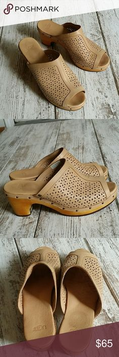"""Host pick! Size 8 Ugg perforated slides *beautiful perforated leather slides/sandels  *wooden outsole (has scratches and fading but really comes off as a distressed look)  *antique brass nail head design  *3"""" heel  *fit is true to size  *rubber outsole  *light tan in color  *retail is $130  Sorry, no trades UGG Shoes Mules & Clogs"""
