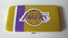 Los Angeles Lakers Basketball Jersey Clutch Shell Wallet by Little Earth. $16.63. The Shell Mesh Wallet can function as a mini purse for a dinner out or a wallet that goes into a larger bag. Full of features such as 5 credit card pockets clear ID sleeve zip change pocket and two full-length pockets this wallet is a winner at the game or any time!. Save 58%!