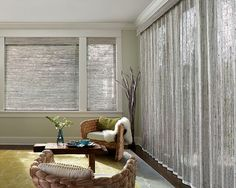 Natural meets modern in this living room. Provenance® Woven Wood Shades and Vertical Draperies ♦ Hunter Douglas window treatments