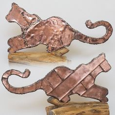 Our Lucy as a unique, life-sized copper cat, handmade with old traditional techniques by our local coppersmith.