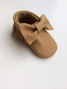 Only $25!  This is our cut tan bow moccasin one of best sellers perfect for a princess