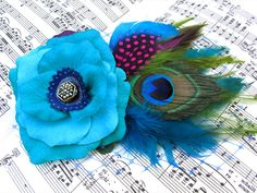 Feather Fascinator turquoise Rose Antique Button by GwendolyneHats. $95.00, via Etsy.