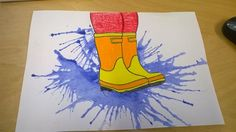 """Vesiväreillä iso """"lätäkkö"""", jota puhalletaan ympäriinsä. Hieman paperia kallistamalla saa aikaan jopa parempaa jälkeä. Saappaat voi tulostaa valmiiksi kaikkein pienimmille taiteilijoille, isommat oppilaat piirtävät itse. (Alakoulun aarreaitta FB -sivustosta / Hanna Puttaa-Vuoriluoto)"""
