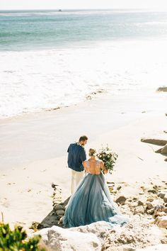 Malibu Beach Wedding -- Hayley Paige Kenny Gown + Chantel Lauren Steel Blue Mae Skirt -- Bride and Groom -- Leis -- Lush florals