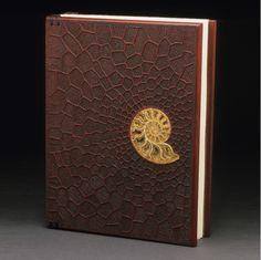 "Mark Doolittle. ""Padauk Book"" 13""h x 10""w x 2""d. African Padauk with inlayed ammonite. Binding by Kathy Doolittle."