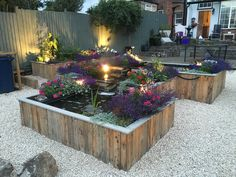 Raised pond - Clad with timber pallets.