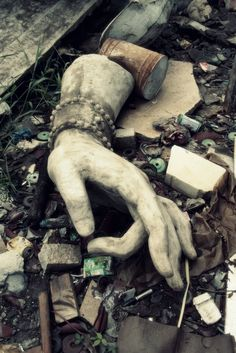 Hand in the gutter. The hand and wrist of what appears to be a Hindu-inspired statue laying in the rubble of an abandonment Abandoned Buildings, Abandoned Places, Show Of Hands, Foto Art, Lost & Found, Wabi Sabi, Oeuvre D'art, Decay, Creepy