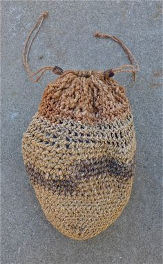 """""""Looped string bag made from 2-ply New Zealand flax leaves and dogbane fibers with two Grey pine nut toggles. .. The black New Zealand flax fibers were dyed in a mixture of acorn / rusty nails solution."""""""