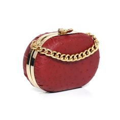 Red ostrich mini leather clutch bag by Laura De La Vega