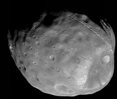 "The larger of Mars' two moons, Phobos, is featured in this stunning black and white image.  The giant feature on the bottom right of the moon is the large crater ""Stickney,"" which is about 6 miles in diameter."
