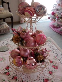 Vintage Pink Christmas - You could make the holder using dollar store plates and small glasses, and then paint, or not!  Beautiful centerpiece!