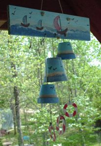 Windchimes made from flower pots and a board. Life preserver rings from washers.