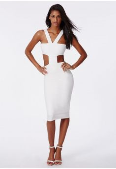 """Exquisite and elegant, this sublime bodycon midi dress will transform you into a movie star siren. Featuring cut out detail and a concealed zip fastening at back.  Approx length 110cm/43.5"""" (Based on a UK size 8 sample)  95% Polyester 5..."""