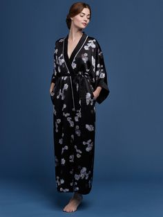 PRINTED SILK SATIN LINED KIMONO STYLE ROBE  Feminine and charming, the flora collection gives nod to the splendors of nature with its floral motif and multihued butterflies. Delicate blooms are intertwined with ethereal butterflies, evoking a sense of serenity in this delightful printed silk satin lined kimono style robe.