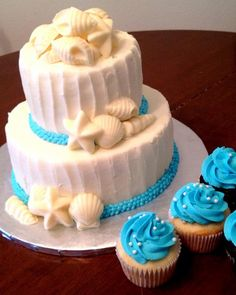 Adorable beach themed wedding cupcakes to match the two-tiered wedding cake #wedding #beach #blue #weddingcupcakes #cupcakes
