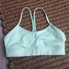 Lululemon Flow Y Bra Mint green with polka dots flow y bra. Small spot on the back mesh but not very noticeable. The stitching in back is fraying some too. Otherwise great, new condition. Color is a deeper mint green than the pictures show. lululemon athletica Intimates & Sleepwear Bras