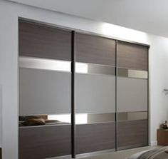 sliding robes hull Grey brown Ontario walnut, bronze mirror, dakar with the lacq. sliding robes hull Grey brown Ontario walnut, bronze mirror, dakar with the lacquered bronze frame Bedroom Closet Doors, Wardrobe Furniture, Bedroom Closet Design, Bedroom Furniture Design, Bedroom Wardrobe, Master Bedroom, Wall Wardrobe Design, Sliding Door Wardrobe Designs, Closet Designs