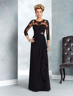 A chiffon and net formal gown with a sheer yoke, ¾ length sleeves, sweetheart neckline, and A-line skirt.