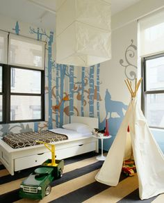 Kids Room - Fun bedroom with teepee playhouse, tan & black striped rug, white modern twin bed with storage, marble Saarinen accent table, brown circles bedding, blue woods mural and rice paper lantern pendant.