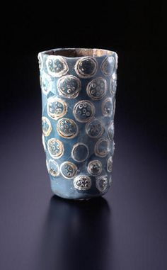 https://flic.kr/p/8549TK | Warring States Period Chinese Glazed Glass Beaker | Glazed glass, 4th-3rd century B.C.E. H. 11.4 cm.   Green glass was wound around an ashy white core, with green and white and blackish brown and white seven star designs painted in glaze on overall surface of the vessel. A single hole pierces the base of the vessel.  Text and image from the website of the Miho Museum.