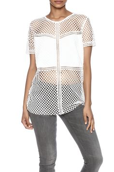 Short sleeve with perforated and solid panel detail.   Perforated Top by Shilla. Clothing - Tops - Casual Clothing - Tops - Short Sleeve Maryland
