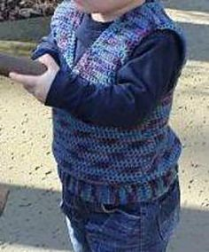 This handsome vest, worked in one piece from the bottom ribbing to the top, is worked in single and double crochet.