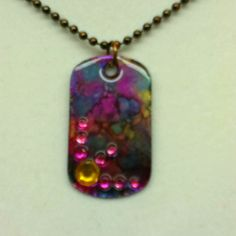Metal dog tag with alcohol inks and stick on gems