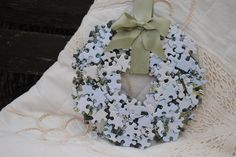 Puzzle Piece Christmas Wreath- I am going to change this up a bit and use colored puzzle pieces to make an Autism Awareness wreath for my sister.