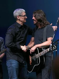 Dave Grohl and Tim Cook Photos - Apple CEO Tim Cook greets Dave Grohl of the Foo…