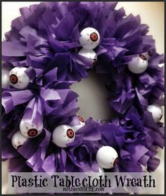 Brilliant! Eyeball Halloween wreath made from a plastic tablecloth from the DOLLAR store. So easy to make and customize for different holidays. And it's weather proof :)