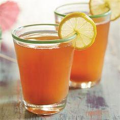 Caribbean Punch: 1 1/2 quarts R.W. Knudsen Family®️ Organic Pineapple Juice 2 quarts Santa Cruz Organic®️ Lemonade Flavored Beverage 1 1/2 quarts R.W. Knudsen Family®️ Cranberry Nectar 2 cups R.W. Knudsen Family®️ Apple Juice Ice cubes 14 lemon slices