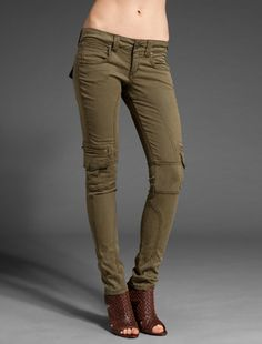 green skinny cargos, brown leather heels and I'd throw in a black blazer with a fitted gray tshirt