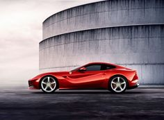 Ferrari F12 Berlinetta.  Enzo once said he thought of woman every time he designed a car.  This lady must have been HOT.