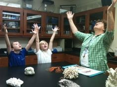 """All students at Canterbury School of Florida get to experience hands-on marine studies at our innovative, 2,800 sq. ft. Cousteau Center for Marine Studies. These kindergarten students are waving their """"polyps"""" to catch food, like sea anemones."""