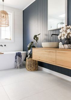 Room tour: A stunning deep blue, coastal luxe bathroom. Panel wall in bathroom, coastal style bathroom, timber floating vanity, bathroom inspiration, blue and timber bathroom, bathroom ideas, rattan pendant in bathroom