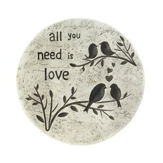 "This flock of birds is ready to impart timeless wisdom to your garden or outdoor space. This lovely cement stepping stone features four little birdies on branches and the phase, ""All you need is love""."