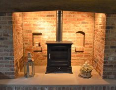 Most current Snap Shots Brick Fireplace surround Popular Best Photos Brick Fireplace log burner Ideas A brick fireplace could be a gorgeous focal point in a Brick Fireplace Log Burner, Inglenook Fireplace, Fireplace Hearth, Fireplace Surrounds, Fireplace Design, Fireplace Ideas, Cottage Living Rooms, Cottage Interiors, Fireplace Lighting
