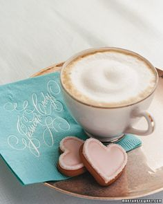 Sweet Treats...                                                        Cookies from Eleni's rest beside cappuccinos and napkins embossed with calligraphy by John DeCollibus.