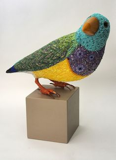 Beautiful Mosaic Bird Sculptures - Dusciana Bravura is the artist behind these breathtaking bird sculptures made of mosaics. Her works like Yellow Beak, pictured above and immediately below, is made out of a mixture of glass paste, millefiori, crystals, iron, cementitious adhesive on fiberglass structure. Its beak is composed of Murano glass.