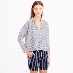 """Designed in New York City, Apiece Apart is a line of elevated basics brought to life through clean lines, simple shapes, impeccable tailoring and beautiful fabrics. Case in point: This fun and flirty shirred top is a chic way to show off the classic polka dot (think: classic cool French girl). <ul><li>Cropped fit.</li><li>Body length: 22 1/2"""".</li><li>Cotton/silk.</li><li>Front slit with hook and eye closure.</li><li>Dry clean.</li><li>USA.</li></ul>"""