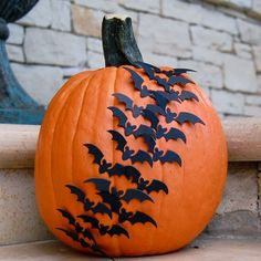 This swarm of bats pumpkin is just one of many alternatives to the traditional Halloween jack-o'lantern. Click through for 22 DIY no-carve pumpkin decoration ideas.