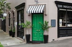 I love black and white striped awnings.  and love that shade of green!