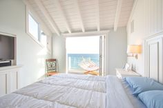The master bedroom has vaulted ceilings and its own deck.