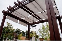 Adding fabric to a wood pace to create some shade on the patio.  traditional patio by b3 Construction Services LLC